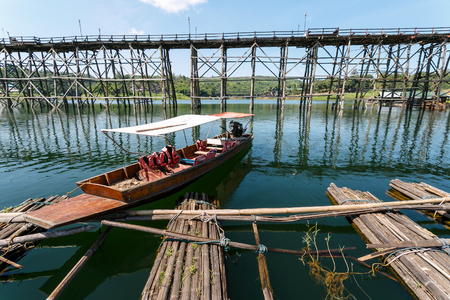 strapped: Boat tour at mon Bridge  and bamboo raft of Sangkhlaburi, Thailand is a attracion. Tourists visit