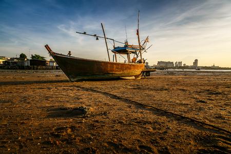 aground: Aground fishing boat on sunset thailand Stock Photo