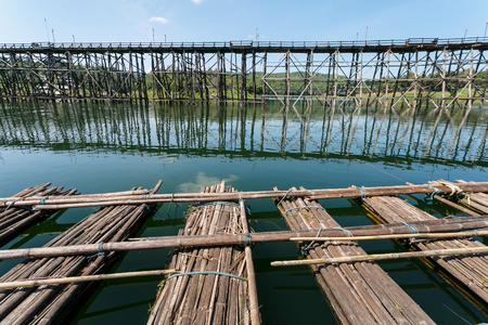 strapped: Mon Bridge  and bamboo raft of Sangkhlaburi, Thailand is a attracion. Tourists visit Stock Photo