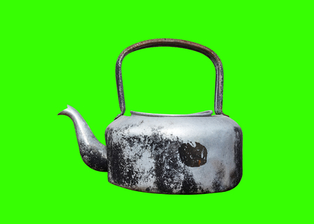 Retro old kettle on green background. isolate Stock Photo