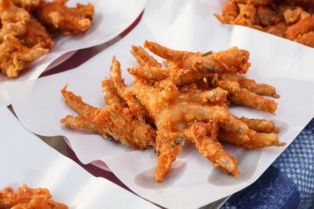 tasty fried chicken at market, fried chicken foot on paper