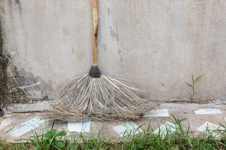 imperata: imperata broom On the cement floor and fresh grass Stock Photo