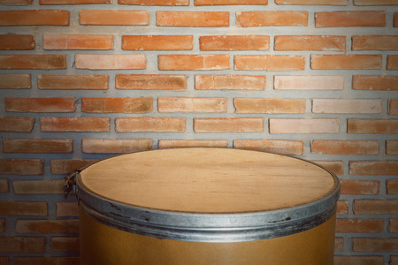 depositing: Containers made of paper, paper tank front set Brick wall background Stock Photo