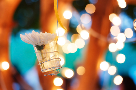 Beautiful flowers in the glass bucket. Decorated in celebration night party. with blur background and soft focus