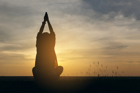 elated: Silhouette woman lifestyle relax at sunset