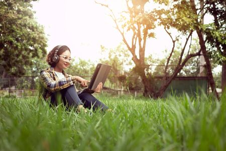 The girl is happy on a holiday by playing the tablet. With online social media
