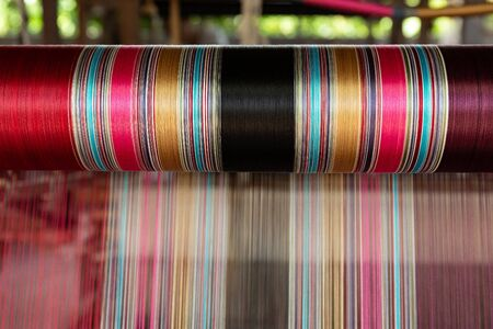 Thai silk threads are colorful, In order to be used for weaving as clothing Beautiful art