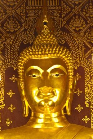 he golden Buddha statue in the church, Thailand photo