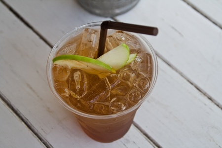 Apple tea with ice and apple pulp. photo