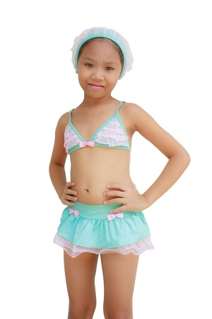 Child wearing swimsuit on white background photo