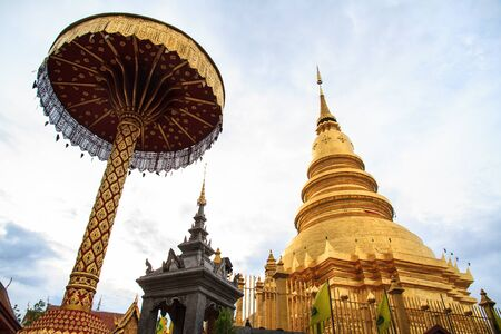 Golden pagoda of Wat Phra That, Lamphun, Thailand  photo