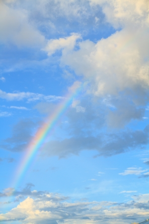 Rainbow, blue sky and white clouds  Stock Photo