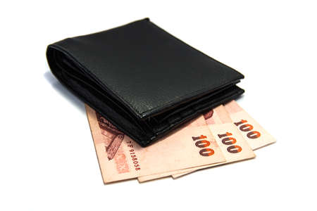 Wallet and bank notes on white background  photo