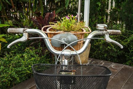 Old black bicycle and flower baskets  photo