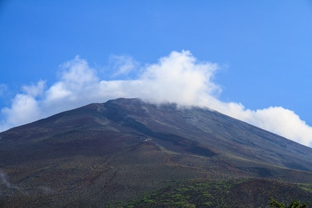 Mount Fuji during the summer with no snow cover. photo