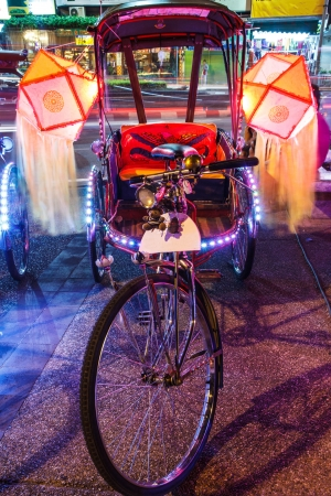 exotic gleam: Thailand on a tricycle adorned with lamps.