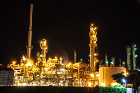 Refineries and oil storage by the ocean at night  photo