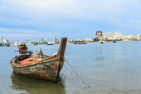 Selling an old rowboat tied to the sea, Pattaya, Chonburi  photo