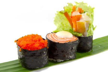 Salmon Sushi, Sushi shrimp eggs and Sushi crab is placed on a banana leaf and white background. photo