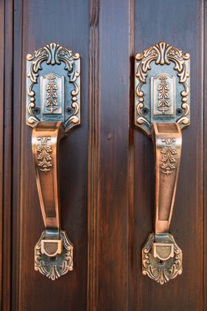 Door handles are made of steel  A beautiful pattern  photo