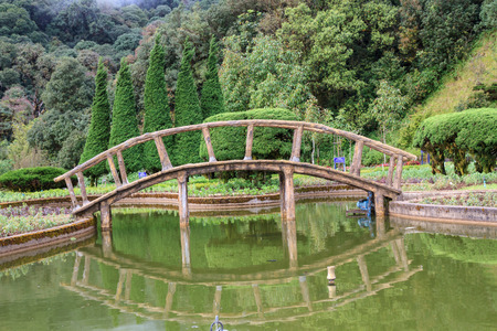 Wooden bridge across the river  Doi Inthanon  Chiang Mai, Thailand  photo