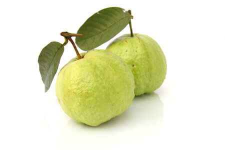 Green guava and reflect on a white background. photo