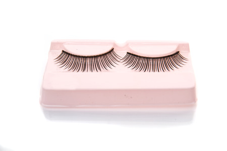 Eyelashes in box on the white . photo