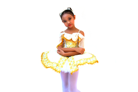 Asian child girl in yellow dress ballet on white background. photo
