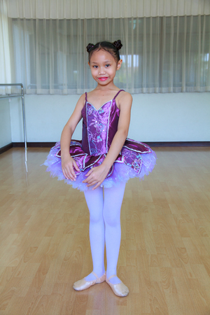 Asian child girl wearing a ballet in ballet room. photo