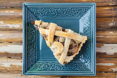 Apple pie put raisins on plate in restaurant. photo