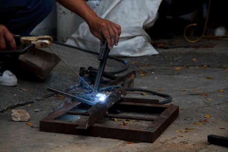 Workers are welding steel at the work