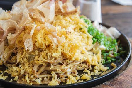 yakisoba: Japan food Yakisoba with pork on black plant.