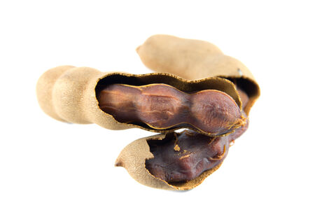 Sweet tamarind fruit on a white background. photo