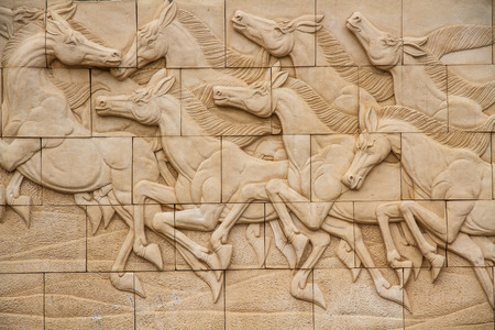 Horse art molding on the wall of Thailand. Stock Photo - 28344441