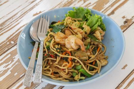 Spaghetti thai style   spicy food add shrimp and squid  photo