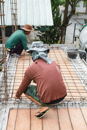 Construction workers on steel trusses in construction site. photo