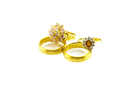 Jewelry: Diamond ring and gold ring on the white background. photo