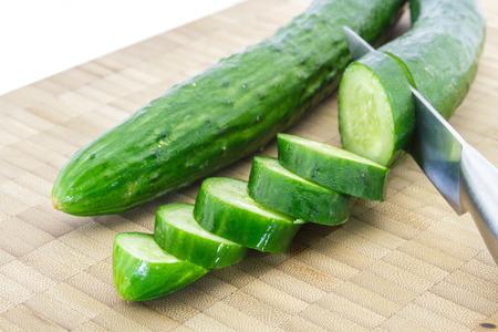 Japanese cucumber slice on chopping block wood. photo