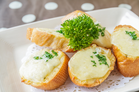 Cheese toast on white dish in restaurant