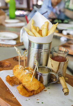 Fish and chips on plate in restaurant photo