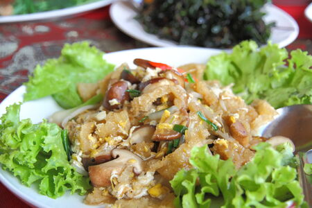 maw: Fried fish maw add shiitake mushroom and lettuce on plate in restaurant.