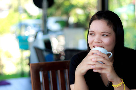Asia woman drinking beverage at the restaurant. photo