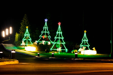 Christmas tree made of light, blurred shot. photo
