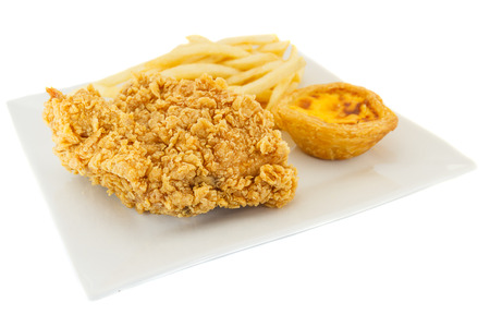 Chicken fried, Tart egg and French Fries on plate.