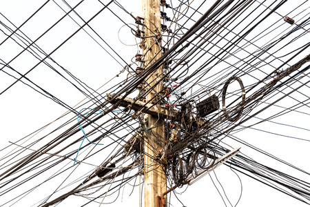power pole: Power pole with Tangle of Electrical wires.