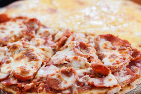 meat lover: Pizza Meat lover with sausage, salami, ham, bacon, pepperoni and cheese in restaurant. Stock Photo