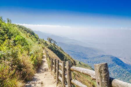 Footpath along mountain and blue sky on Kew Mae Pan Nature Trail, Doi Inthanon National Park, Chiang mai, Thailand. photo