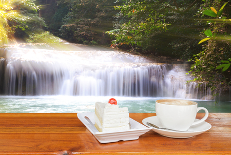 Concept: Coffee on wood table backdrop Waterfall. photo