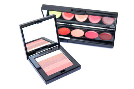 pink and brown: Cosmetic: Eye shadow color pink, brown, yellow, red and tan isolated on white background. clipping path in picture. Stock Photo