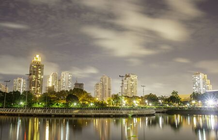 Cityscape night shot from Queen Sirikit National Convention Center Bangkok Thailand. photo